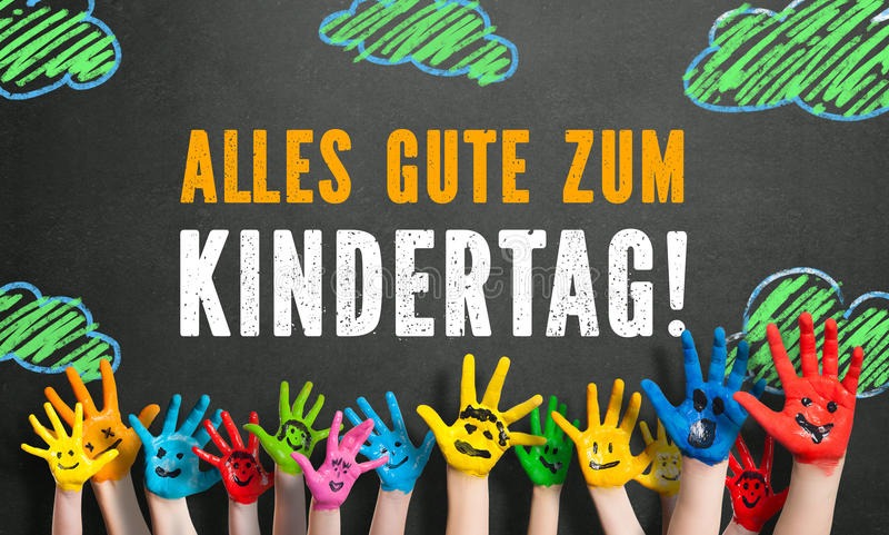 Many painted kids hands with smileys and the message `Happy Childrens Day` stock images