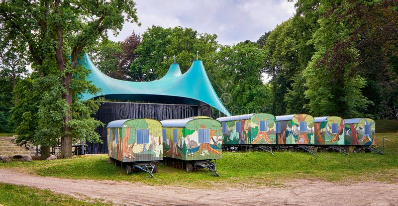 Many painted trailers at a concert site in the woods. Schwerin, Germany. Tour, bus, construction, industry, mobile, retro, recreation, tourism, travel royalty free stock photos