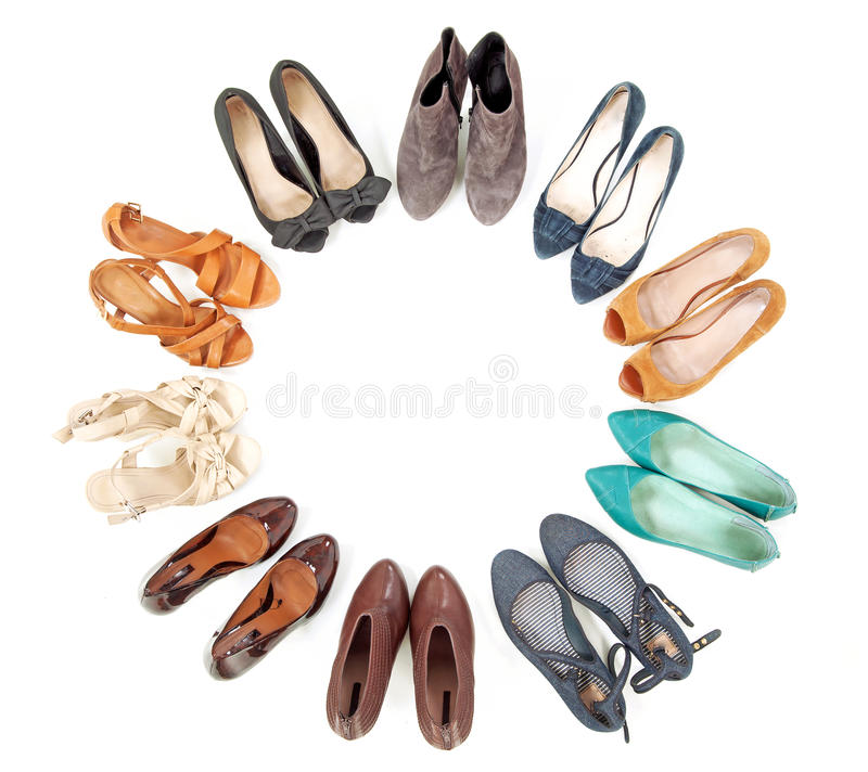 Many pairs of shoes. In circle stock photography