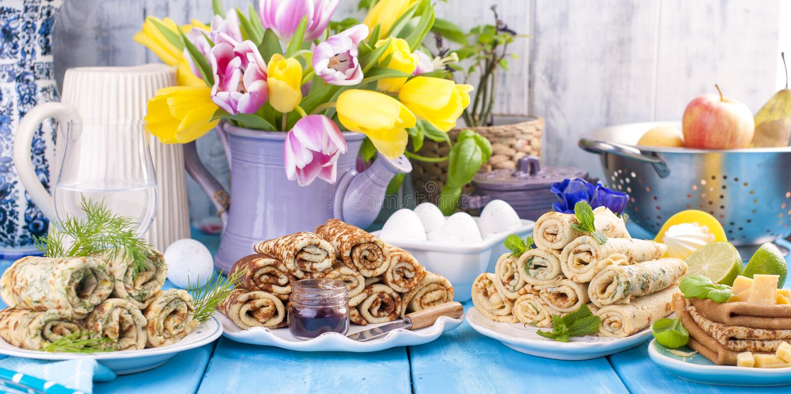 Many pancakes with different fillings and flavors. Delicious traditional food in the spring. Homemade baking. Flowers and royalty free stock photo