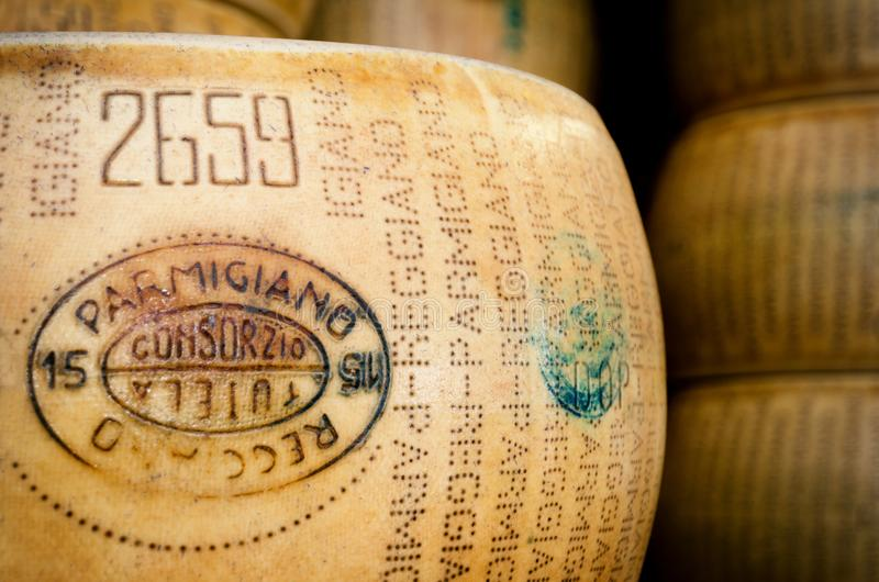 Many Parmigiano Reggiano cheese wheels. BRA, ITALY - SEPTEMBER 18, 2017: Many Parmiggiano Reggiano typical italian cheese wheels stacked toghether in Bra stock image