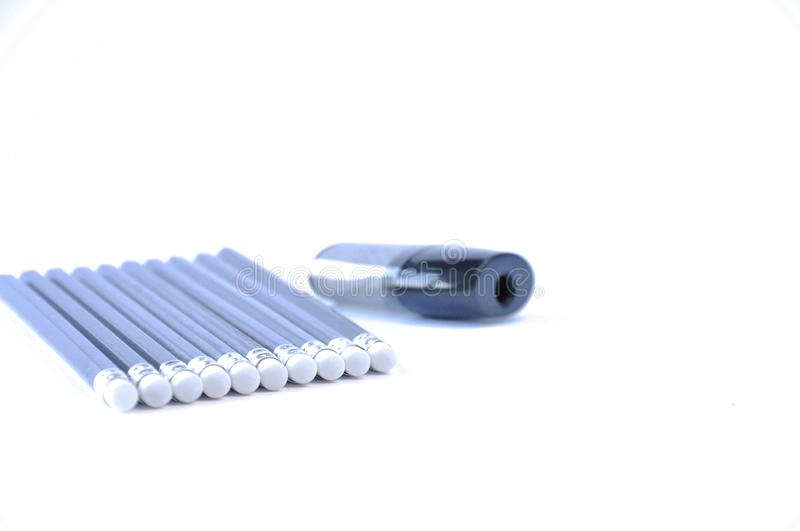 Pencils and sharpener on the table stock photos