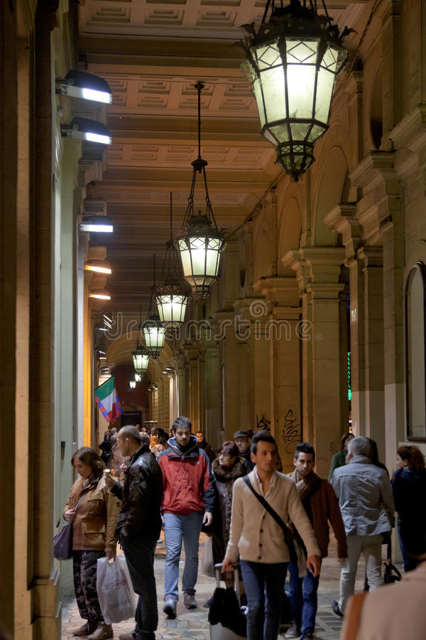 Many people in Bologna s passage way at night