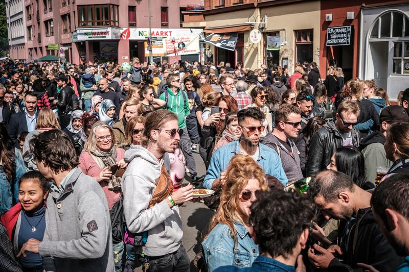 Many people on crowded street celebrating labor day in Berlin, Kreuzebreg. Berlin, Germany - May 01, 2019:Many people on crowded street celebrating labor day in royalty free stock images