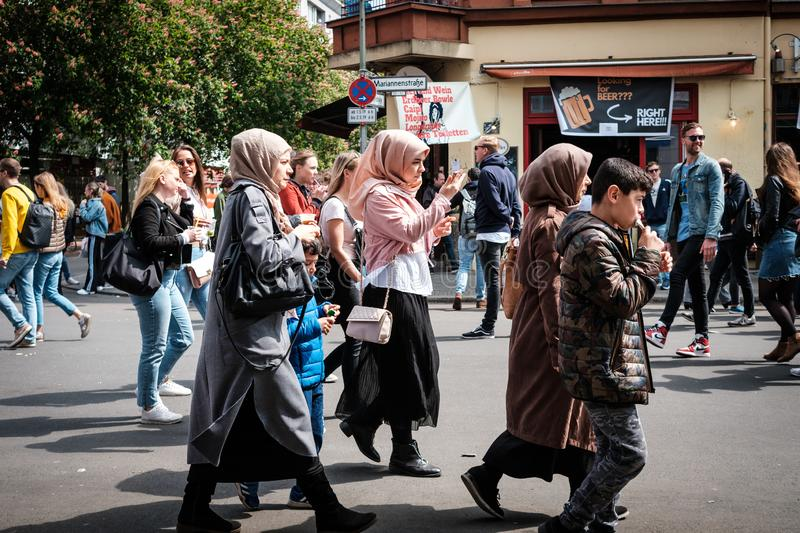 Many people on crowded street on labor day in Berlin, Kreuzberg. Berlin, Germany - May 01, 2019: Many people on crowded street on labor day in Berlin, Kreuzberg stock photography