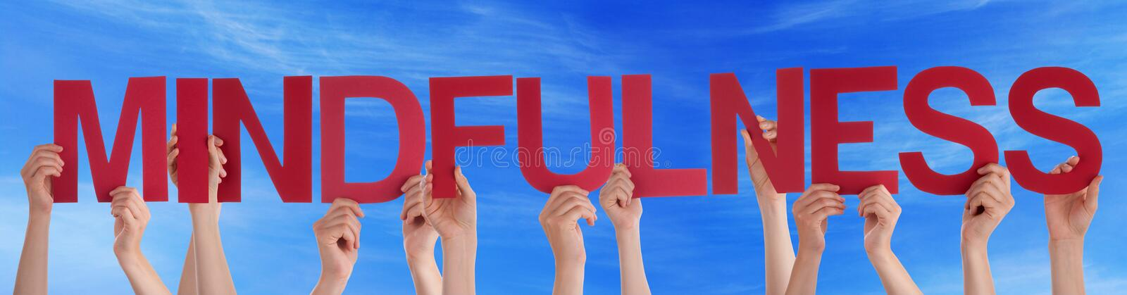 Many People Hands Holding Red Straight Word Mindfulness Blue Sky stock photography