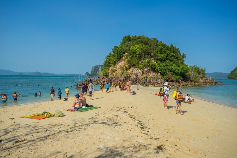 Many people playing and swimming in the sea at Phak Bea Island in Krabi Province Thailand. KRABI THAILAND 3 FEB 2018: Many people playing and swimming in the sea royalty free stock image