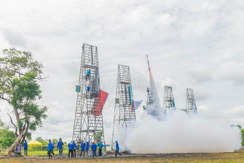 Many people are preparing fireballs, the rocket taking off to the sky, Thailand community rocket festival at Phanom Phrai District stock photography