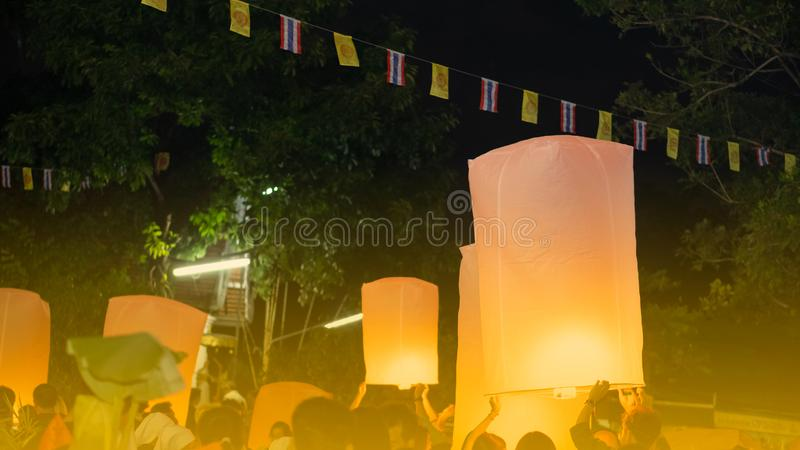 Many people are releasing lanterns stock photo
