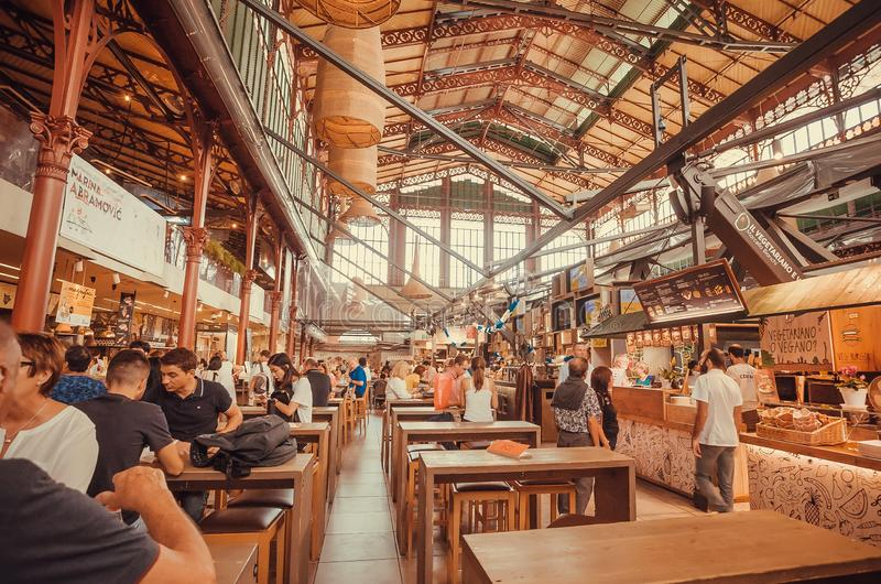 Many people waiting for order inside the modern food court over the city market royalty free stock images