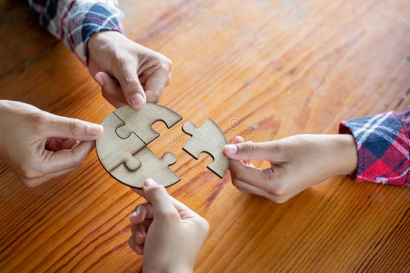 Many persons holding pieces of jigsaw puzzle,Teamwork concept,,Business connection stock photo