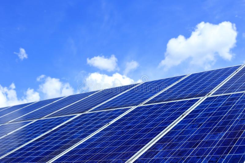 Many photo-voltaic modules on a top of a roof. With blue sky background royalty free stock photography