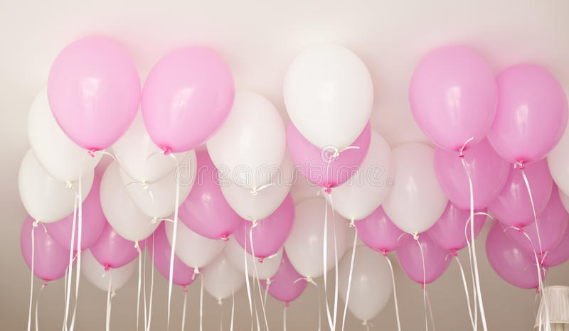 Many pink balloons for girl`s Birthday. royalty free stock image