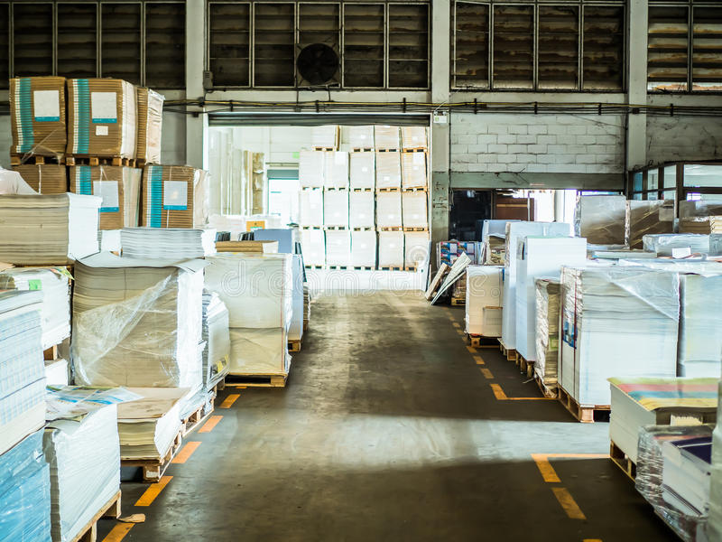 Many plastic packaging of paper in a large warehouse. stock image