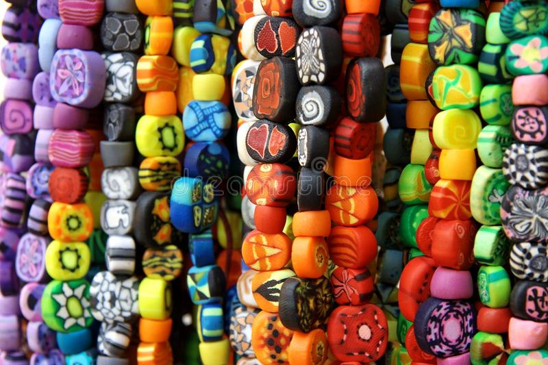 Many polymer clay hipster beads on street market stock images
