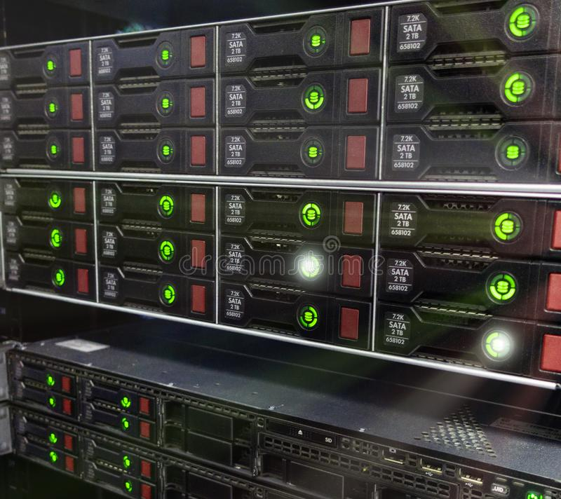 Many powerful servers running in the data center server room. Disk storage array stock photo