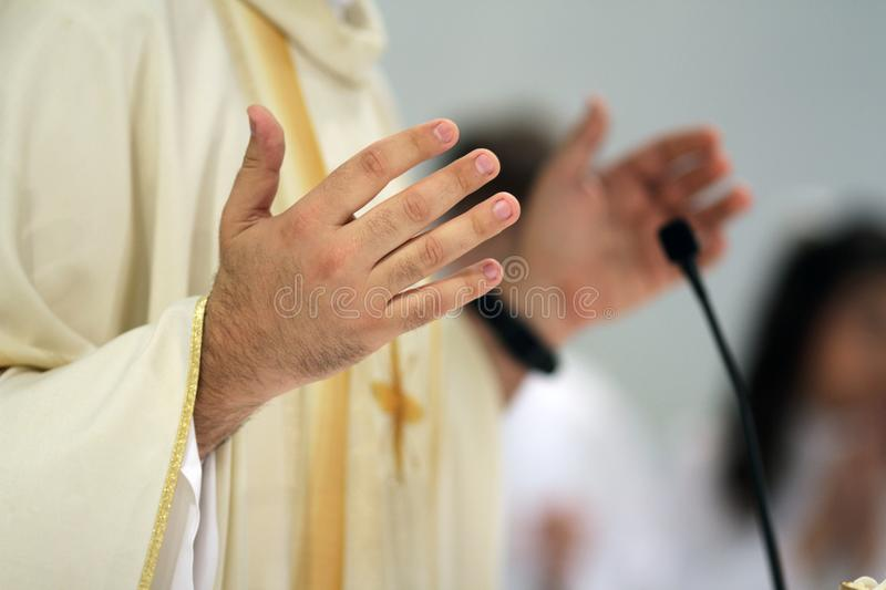 Many of a priest during mass. Hand details stock photo