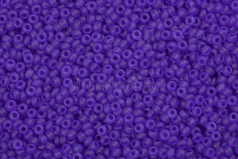 Many purple seed beads. stock image