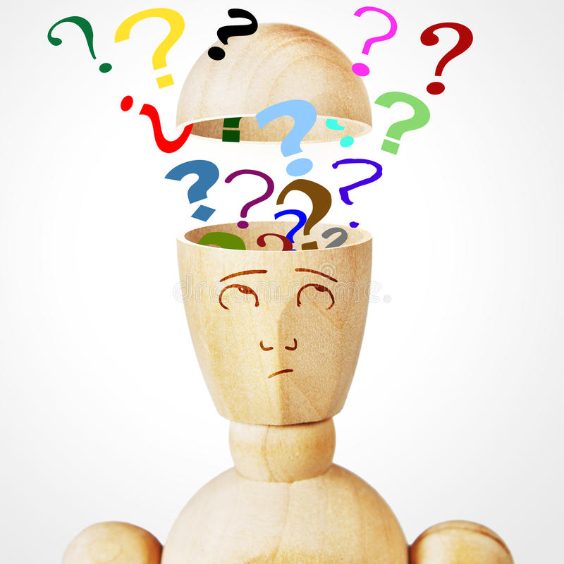 Many question marks into the human head. Abstract image with a wooden puppet stock photos