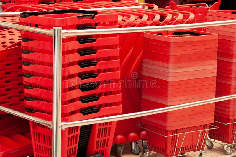 Many red baskets in the supermarket. Shopping basket. Retail business. stock photo