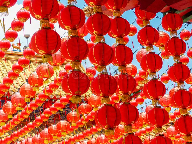 Many Red Chinese lanterns at a Chinese Temple. A colourful and dramatic red canopy of hanging chinese lanterns at a chinese temple in Kuala Lumpur, Malaysia, at stock photo