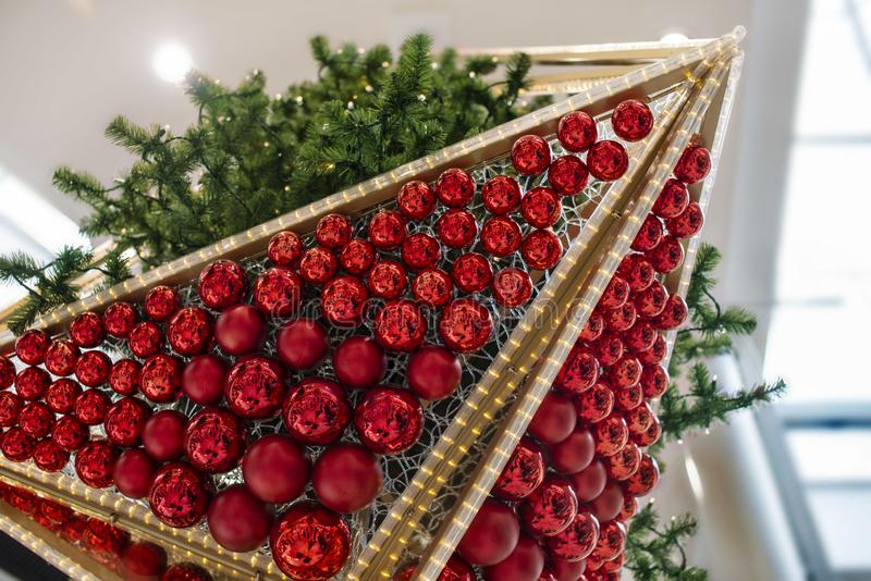 Many red Christmas balls and Christmas tree royalty free stock photography