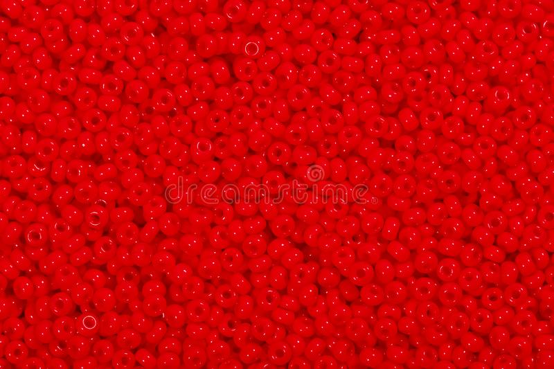 Many red glass beads. Photo beads for background. stock photography