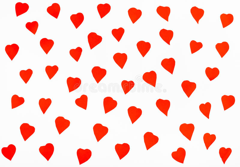 Many red hearts cut out from paper on white royalty free stock photos