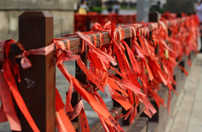 Red streamers on the railings royalty free stock photography