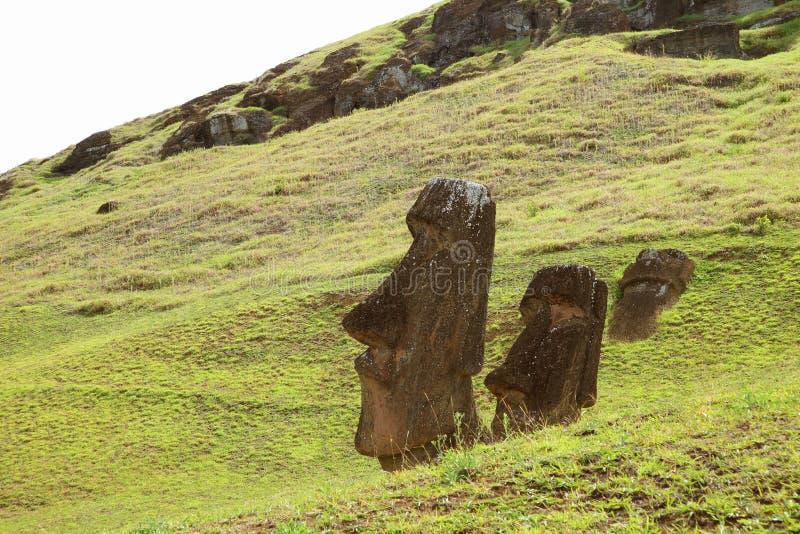 Many remains of huge Moai on the slope of Rano Raraku volcano, Rapa Nui national park, Archaeological site on Easter Island. Chile stock photography