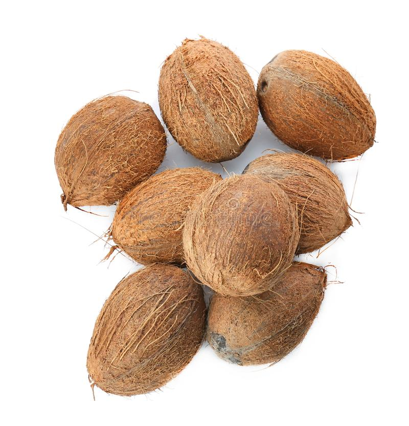 Many ripe coconuts on background royalty free stock photo