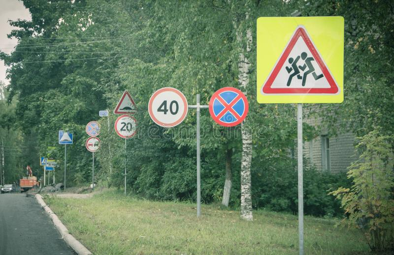 Many road signs along the road. Traffic signs. Road signs royalty free stock image