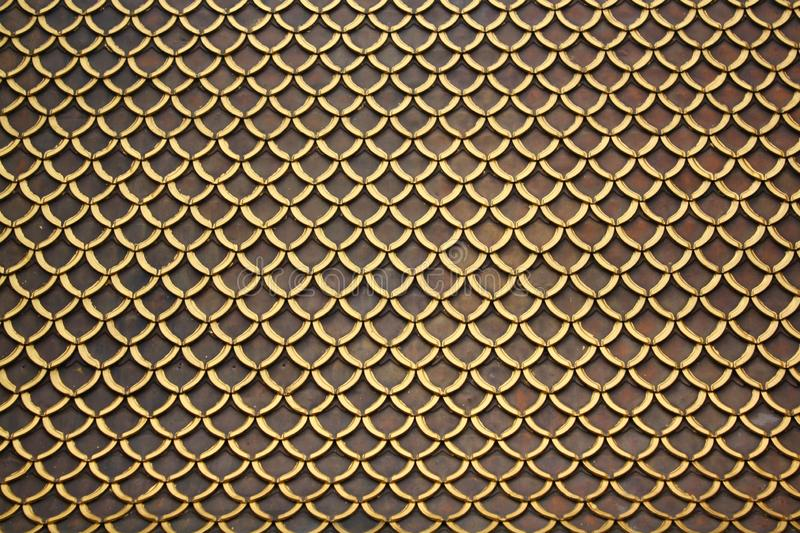 Many roof tile designs. There are gold and brown colors. For backgrounds and wallpapers royalty free stock image