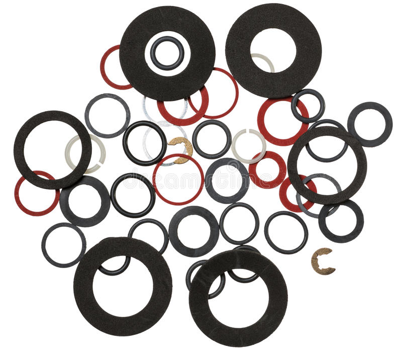 Many round rubber gaskets. For sanitary fittings stock images