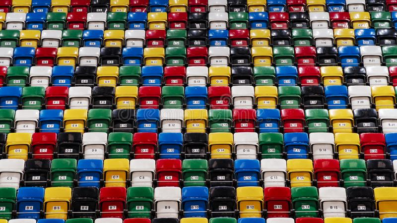 Many rows of bright colorful plastic seats, grandstand stadium. For background stock photography