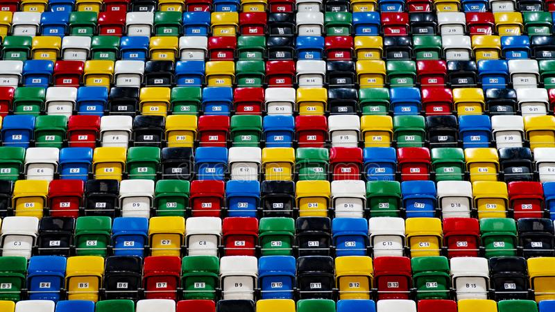 Many rows of bright colorful plastic seats, grandstand stadium. For background stock photo
