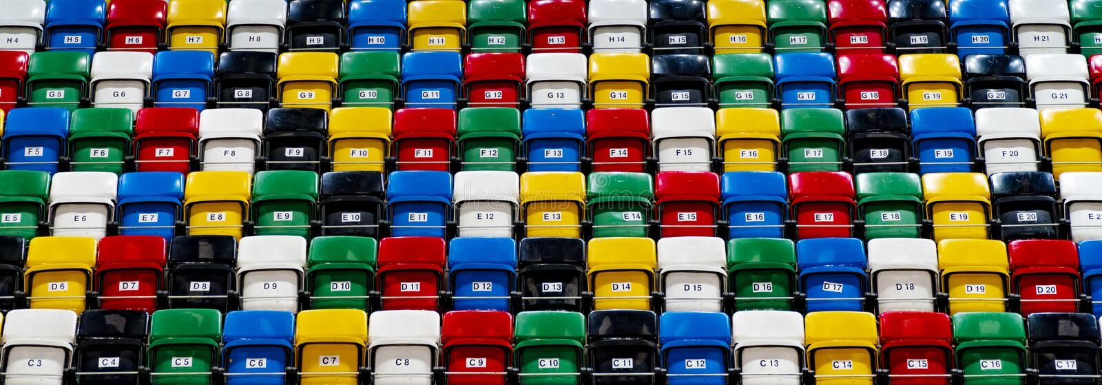 Many rows of bright colorful plastic seats, grandstand stadium. For background stock image