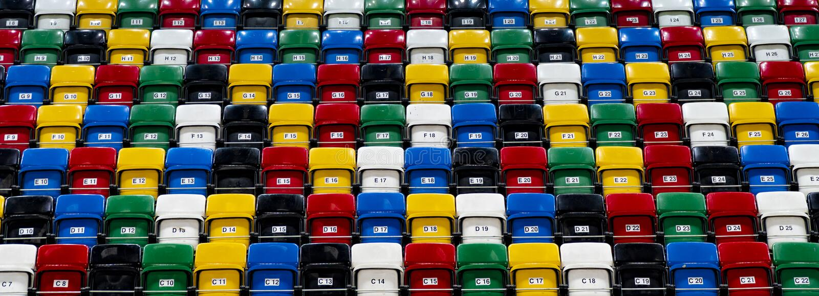Many rows of bright colorful plastic seats, grandstand stadium. View on rows of plastic seats in a grandstand, pattern of folding chair in a stadium, sitting stock photos