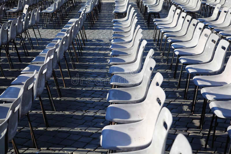 Download Many rows of gray chairs. stock photo. Image of catholicism - 18595456