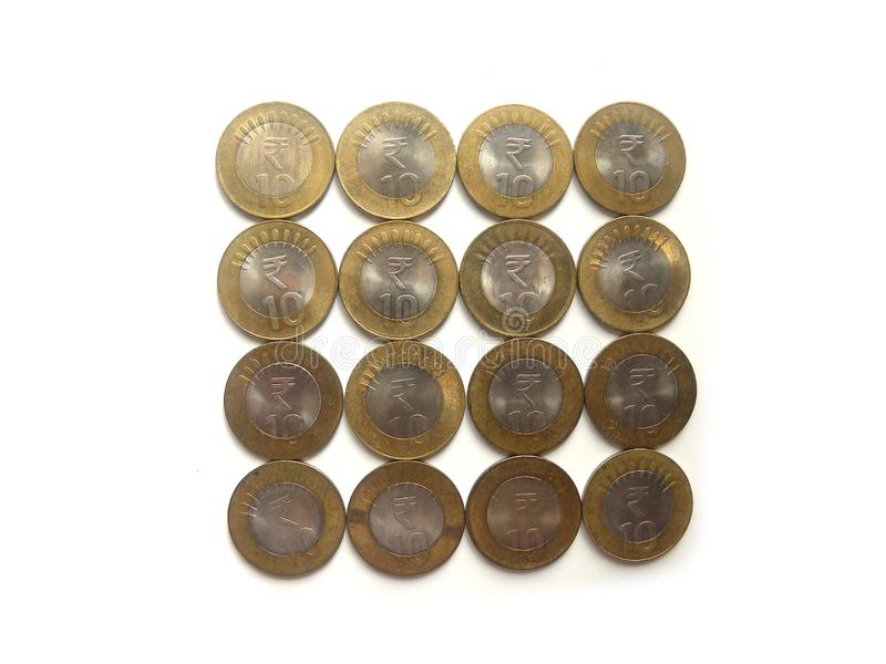 Many 10 rupees coins. Many ten rupees coins India on white background royalty free stock image