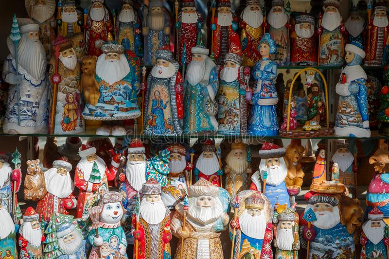 Many Russian colorful dolls - Santa Clauses, snow maidens, snowmens stand on the shelf in the store in anticipation of foreign tou stock images