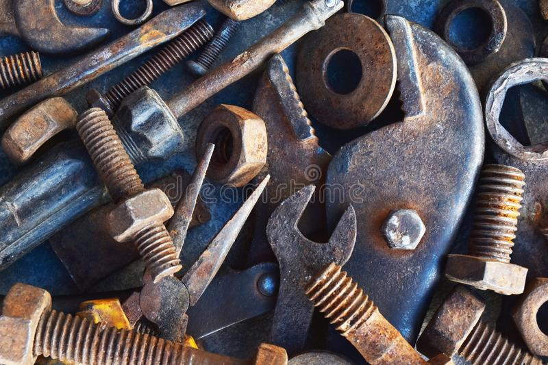 Many rust steel on cement ground. Abstract ancient angle background backgrounds bolt brown closeup concrete copy detail details dirt dirty equipment factory royalty free stock photo