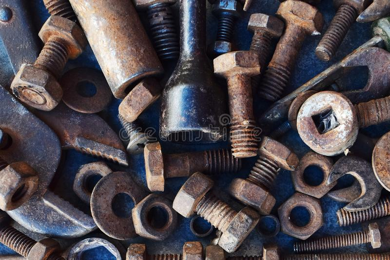 Many rust steel on cement ground. Abstract angle background backgrounds brown closeup concrete copy detail details dirt dirty equipment factory floor group half stock photos
