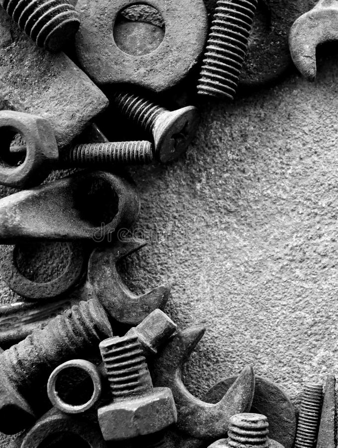 Many rust steel on cement ground in black and white photography. Abstract ancient angle background backgrounds bolt closeup concrete copy detail details dirt stock photo