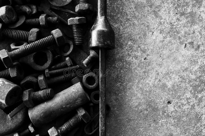 Many rust steel on cement ground in black and white photography. Abstract, ancient, angle, background, backgrounds, bolt, closeup, concrete, copy, detail stock photography