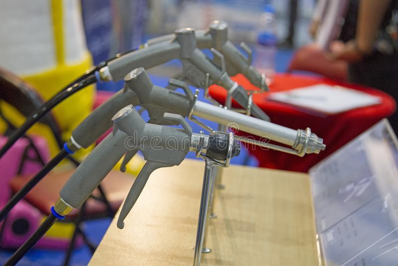 Many sandblasting guns are located on the table stock photo