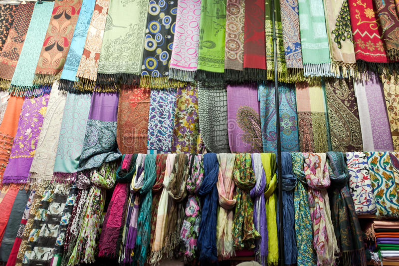Many scarfs made from silk. Many things are selling in Grand Bazaar (Grand Market) Istanbul, Turkey royalty free stock photo