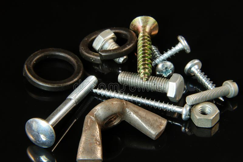 A many screws, bolts, washers, nails and nuts royalty free stock photography
