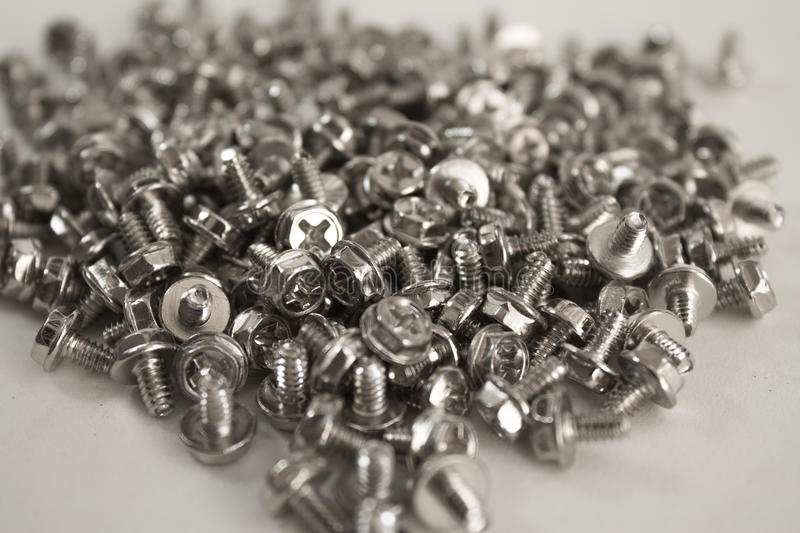 Many screws stock photography