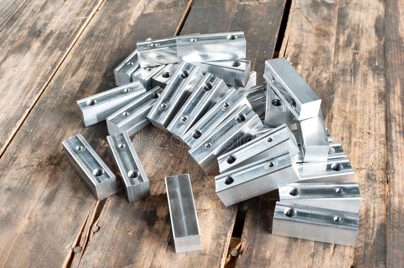 Many semi-finished square iron details - blank. Metal engineering. stock photos